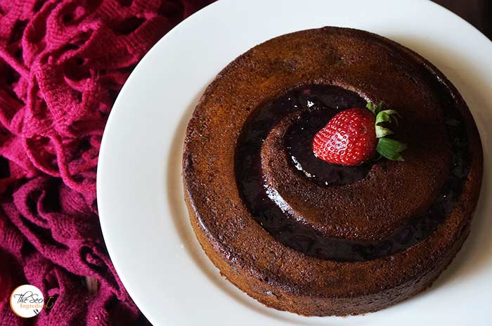 Eggless Black Grape Cake with Strawberry Jam Glaze